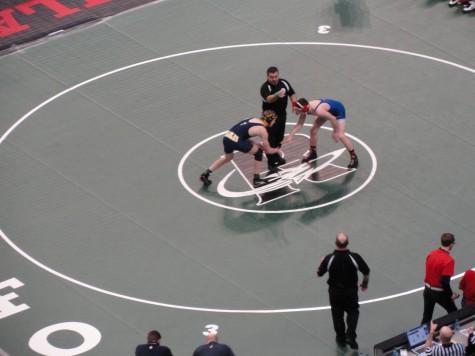 Ryan Kusch prepares to wrestle his opponent