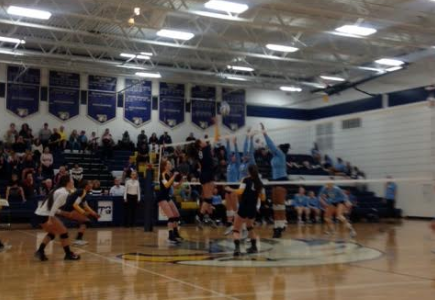 Junior Kelly Opat goes up for a spike