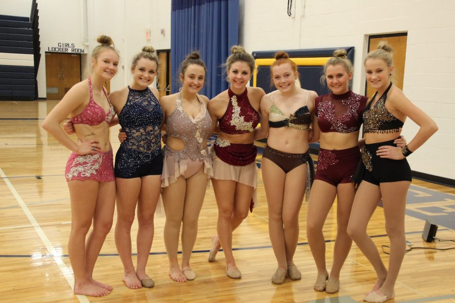 The girls getting ready for the busy day! (Left to right:  Claire Page, Paige Pettijohn, Allie Wollman, Julia Johnston, Grace Kroells, Megan Foht, and Olivia Gullickson)