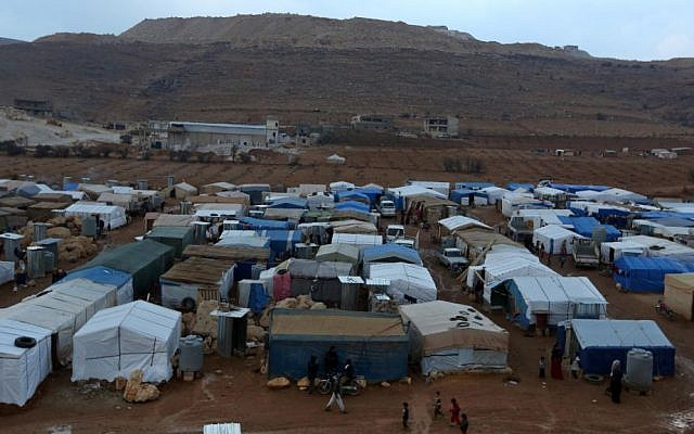 A Syrian Refugee Camp in eastern Lebanon - Photo Credit: https://www.timesofisrael.com/un-lebanon-to-host-1-5m-syrian-refugees-by-years-end/